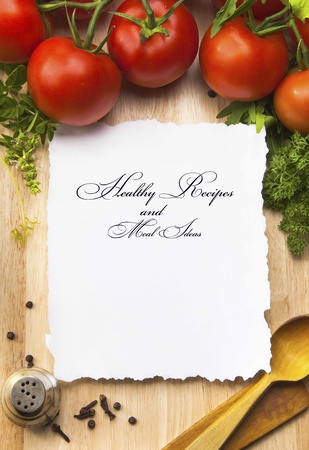 recipe: fresh vegetables and spices on the  wooden background and paper for notes Stock Photo