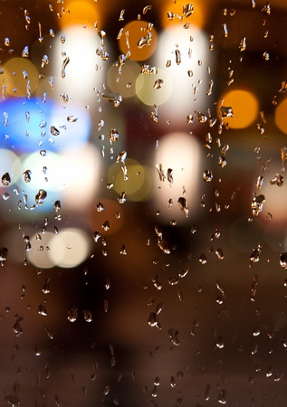 autumn rain: Wet the window with the background of the autumn night city Stock Photo