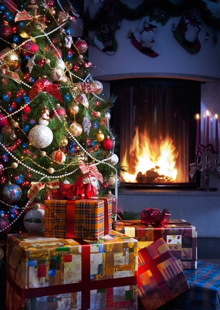 Christmas Tree and Christmas gift boxes in the interior with a fireplace photo