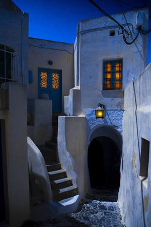 Narrow night street on island Santorini Stock Photo - 10650275