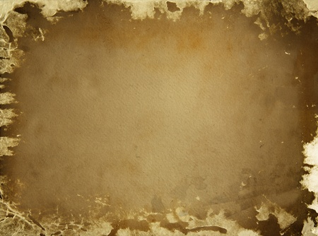 Old torn brown paper background covered with black spots photo
