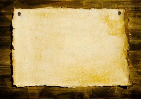 art old grunge paper background on wood photo