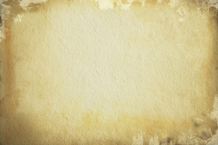 western background: Old torn brown paper background covered with black spots