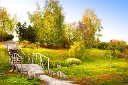 old decorative wooden bridge in autumn park Stock Photo - 10958861