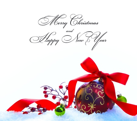 Red Christmas ball with ribbon and bow lying on white snow Stock Photo - 11316860