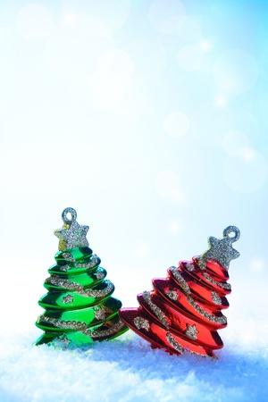 two Christmas tree toy on white snow Stock Photo - 11316861