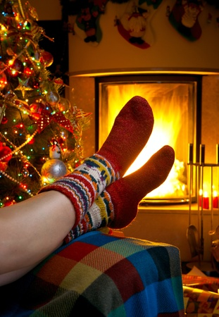 girl resting in room with fireplace Christmas photo
