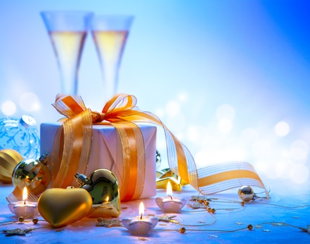 Christmas greeting card ( glasses of champagne vine and Christmas gifts, New Year party ) Stock Photo - 11557528