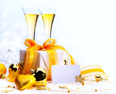 Christmas greeting card ( glasses of champagne vine and Christmas gifts, New Year party ) Stock Photo - 11557526