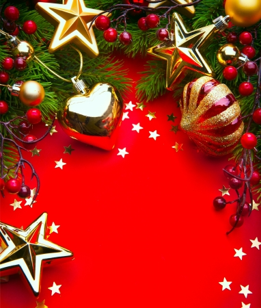 Design a Christmas greeting card with Christmas Decorations on a red background photo