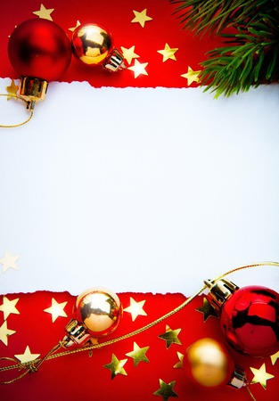 Design a Christmas greeting with a paper on a red background Stock Photo