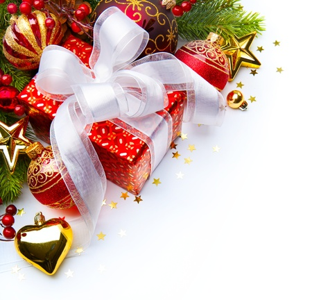 Christmas card with gift boxes and Christmas decorations on a white background Stock Photo - 11557819