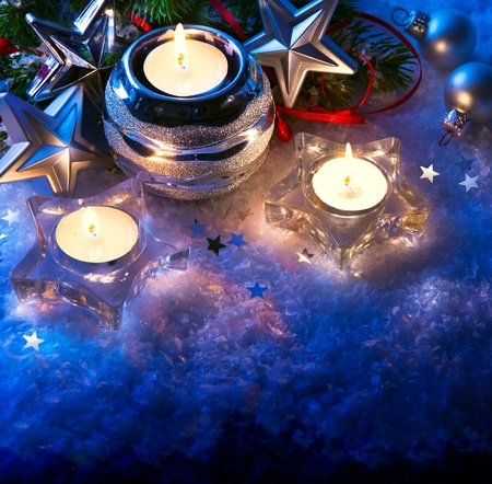 christmas greeting card with christmas candle decoration and christmas decoration on blue background photo