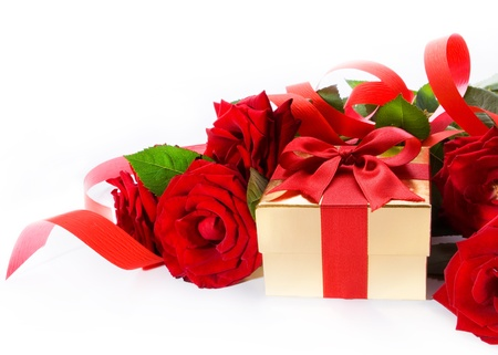 Valentines Day golden gift box and red roses on a white background photo