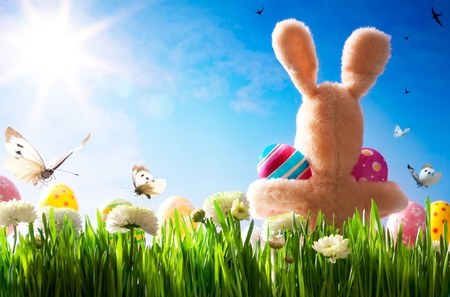art  Easter teddy bunny and Easter eggs on green grass  photo