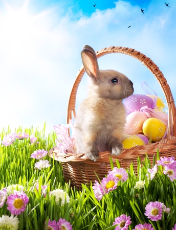 easter decorations: Easter basket with decorated eggs and the Easter bunny Stock Photo