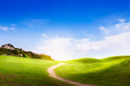 spring  landscape with green grass, road and clouds  photo