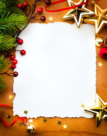 Design a Christmas greeting card with white paper on a red background photo