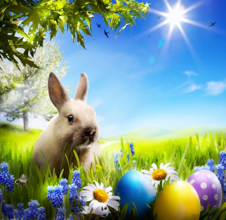 art Little Easter bunny and Easter eggs on green grass Stock Photo - 18412759