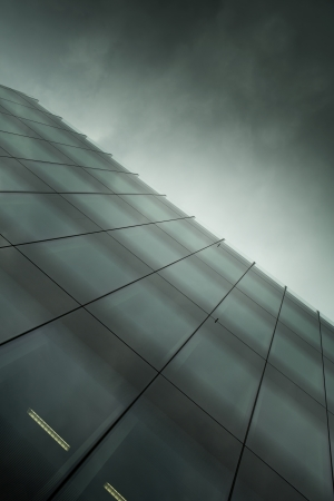 detail: modern glass business building at night