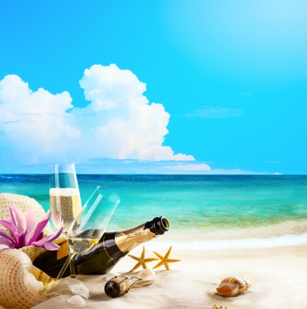 romantic sea beach  wine Glasses and Champagne Bottle on sand Stock Photo