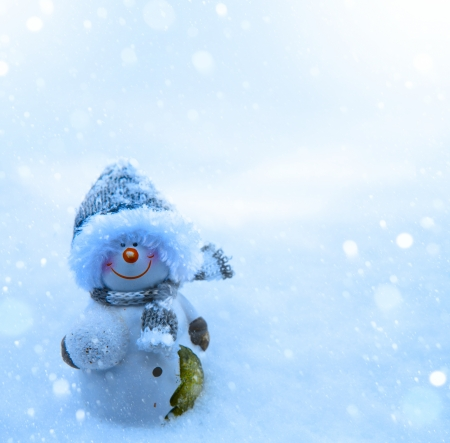 Art Christmas snowman and blue snow background photo