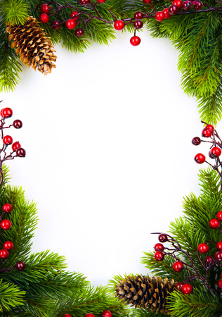 christmas frame with fir and Holly berry on white paper background photo