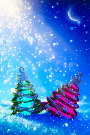 two Christmas tree on blue night background photo