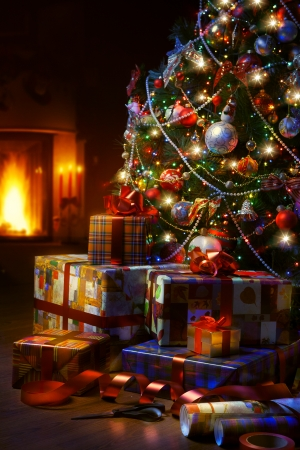christmas fireplace: Christmas Tree and Christmas gift boxes in the interior with a fireplace Stock Photo