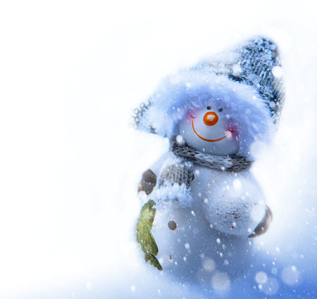 Art smiling snowman, blank page corner  photo