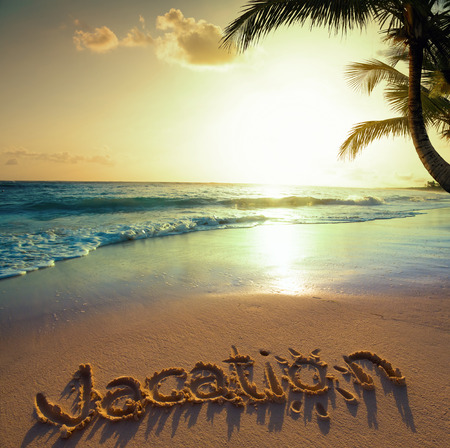 Art Summer vacation concept--vacation text on a sandy ocean beach  photo