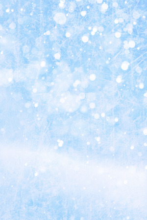 Art falling snow on the blue background Stock Photo