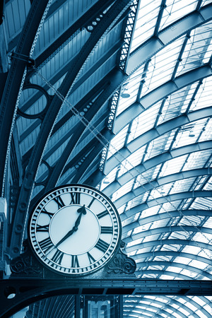 Clock on the  modern building in the subway station