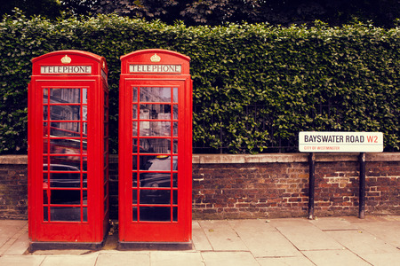 telephone box: art row of traditional phone boxes in London city