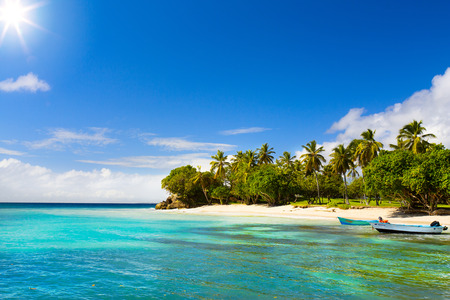 Art Caribbean beach with fishing boat 스톡 콘텐츠
