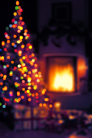 background lights: art Christmas scene with tree gifts and fire in background Stock Photo