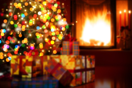 christmas fireplace: art Christmas scene with tree gifts and fire in background Stock Photo