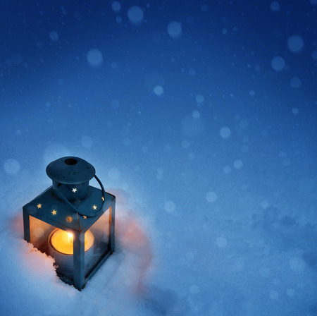 by candle light: art Christmas lantern with snowfall