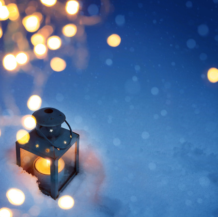 winter season: art Christmas lantern with snowfall