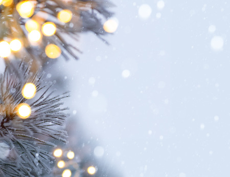 snowy christmas tree light Stock Photo