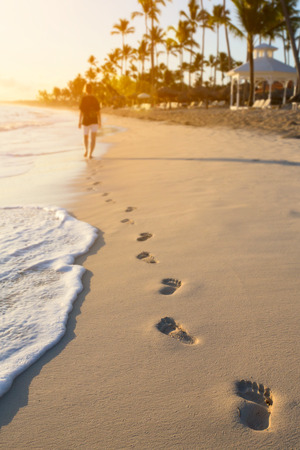 Morning walk on the beach in summer Stock Photo