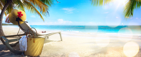Beach chair and hat on sand beach. Concept for rest relaxation holidays spa resort.