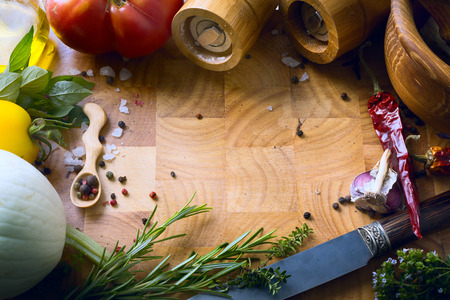food menu: art fresh vegetables and spices on the wooden background; food recipes Stock Photo
