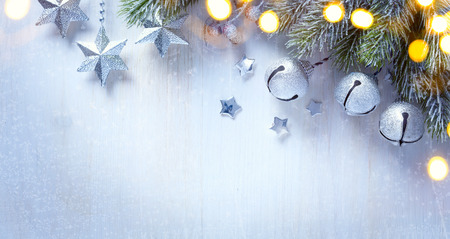 Christmas background with a silver ornament, christmas stars, berries and fir in snow Stockfoto