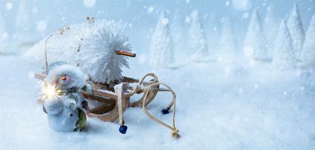 art Christmas background with Christmas tree on Santa sleigh Stock Photo