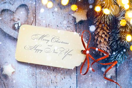 Kerst achtergrond met boom licht en kerst papieren kaart Stockfoto