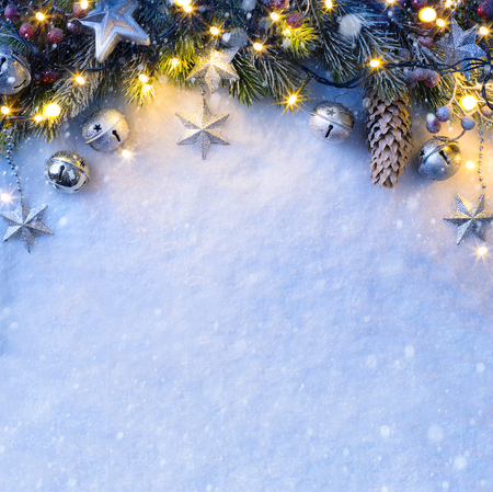 Christmas background with a silver ornament, christmas stars, berries and fir in snow Stok Fotoğraf
