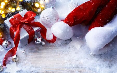 Christmas festive background with Christmas balls and gift box