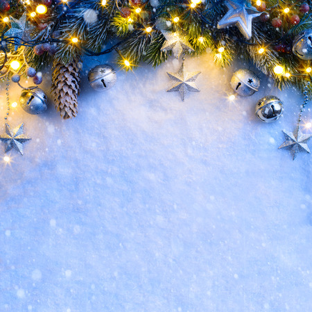 christmas stars: Christmas background with a silver ornament, christmas stars, berries and fir in snow Stock Photo