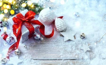 box design: Christmas gift box on snow background and holidays light Stock Photo